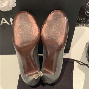 CHANEL Shoes - Chanel classic lamb skin camielia pumps.